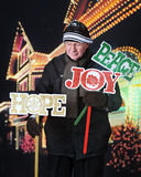 Senior Placing Christmas Yard Signs Royalty Free Stock Photos