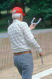 A senior playing a game of horseshoes Royalty Free Stock Image