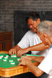 Senior playing mahjong Stock Image