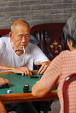 Senior playing mahjong Stock Photo
