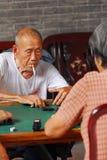 Senior playing mahjong. Chinese old man playing mahjong gambling Stock Photo