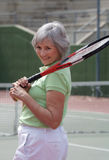 Senior Playing Tennis. Active senior on the tennis court Stock Image