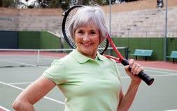 Senior Playing Tennis. Active senior on the tennis court Stock Photos
