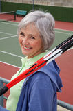 Senior Playing Tennis. Active senior on the tennis court Stock Images
