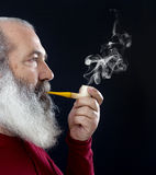 Senior portrait with white beard and pipe Royalty Free Stock Photos