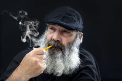 Senior portrait with white beard and pipe Royalty Free Stock Photography