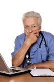 Senior positive doctor Stock Photos