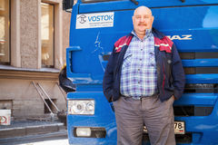 Senior positive truck driver with mustaches Royalty Free Stock Images