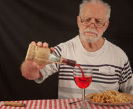 Senior Pouring A Drink Royalty Free Stock Photo