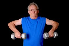 Senior Power. Senior citizen fitness training by lifting weights Royalty Free Stock Photos