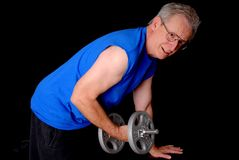 Senior Power. Senior citizen fitness training by lifting weights Stock Photos