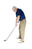 Senior practicing golf at home. Royalty Free Stock Images