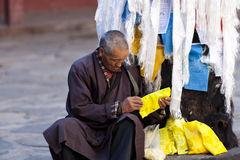Senior prayer in Tibet Stock Photo