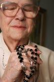 Senior praying. A senior woman praying god Royalty Free Stock Images