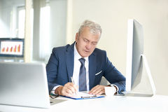 Senior professional man in the office Stock Photography