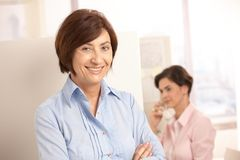 Senior professional woman with assistant Royalty Free Stock Photo