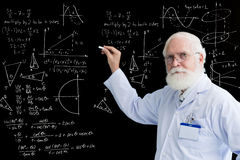 Senior professor. Of math whiting formulas on blackboard stock photo