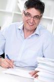 Senior professor review tests stock image