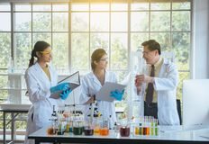 Senior professor teaching to medical student for analyzing data research information together in the laboratary. Senior professor teaching to medical students royalty free stock photos