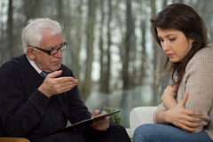 Senior psychotherapist and young patient Stock Photography