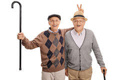 Senior pulling a bunny fingers prank on his friend Royalty Free Stock Photography