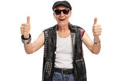 Senior punk rocker giving two thumbs up Stock Photo