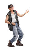 Senior punk rocker playing air guitar. Full length portrait of a senior punk rocker playing air guitar isolated on white background stock images