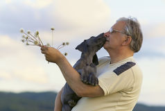 Senior with puppy Royalty Free Stock Photos