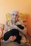 Senior and puppy Royalty Free Stock Photos