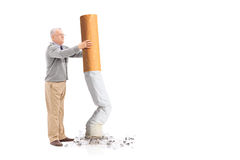 Senior putting out a giant cigarette Royalty Free Stock Images