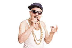 Senior rapper smoking a cigar and making hand sign Stock Image