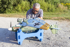 Senior RC modeller and his new plane model Royalty Free Stock Image