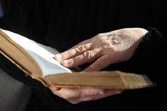 Senior reader hands with old book Stock Image