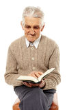 Senior reading a book Royalty Free Stock Image