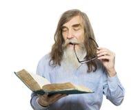 Senior reading book. Old man education, elder with beard. Isolated white background Royalty Free Stock Photo