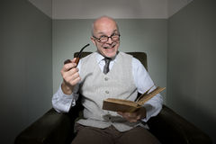 Senior reading in his living room Royalty Free Stock Images