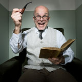 Senior reading in his living room Royalty Free Stock Photo
