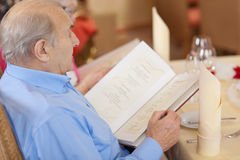 Senior reading the menu Royalty Free Stock Photo