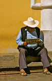 Mexican senior reading newspaper Royalty Free Stock Photo