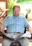 Senior is reading  newspaper Stock Photo