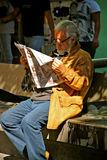 Senior reading newspaper, Mexico Royalty Free Stock Images