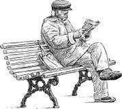 Senior reading a newspaper Royalty Free Stock Photos