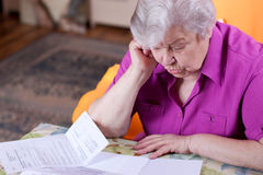 Senior reads papers and works hard Royalty Free Stock Photo