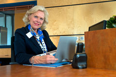 Senior receptionist Royalty Free Stock Image
