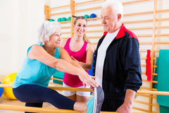 Senior at rehab in physical therapy. Having rehabilitation session Stock Photography