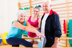 Senior at rehab in physical therapy Stock Image