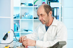 Senior electronics repair tech Royalty Free Stock Photos