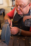 Senior repairman grinding Royalty Free Stock Images