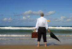 Senior retired business man beach retirement freedom, copy space. Businessman looking into distance on a tropical beach.  Copy space Stock Photo