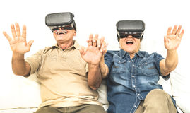 Senior retired couple having fun together with virtual reality glasses stock images